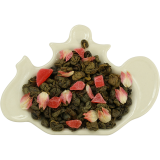 Zielona herbata z dodatkiem papai, szarłatu oraz naturalnym aromatem truskawki i śmietanki